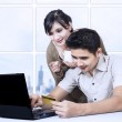 Asian couple paying online in office using credit card — Stock Photo