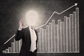 Profitable bar chart with lightbulb head man — Stock Photo