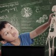 Little boy learns human anatomy - Stock Photo