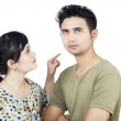 Angry girlfriend pointing at boyfriend on white — Stock Photo