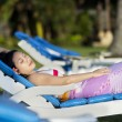 Attractive woman sunbathing at beach resort — Stock Photo