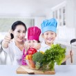 Happy family chef and vegetable at home — Stock Photo