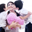Happy mom kissed by children — Stock Photo