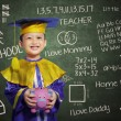 Happy scholar dressed toddler with piggybank — Lizenzfreies Foto