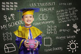 Happy scholar dressed toddler with piggybank — Stock Photo