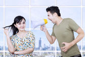 Husband angry at wife using megaphone — Stock Photo