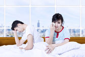 Couple fight on bed in apartment — Stock Photo