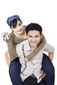 Girlfriend holds key lifted by her boyfriend — Stock Photo