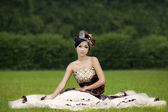 Attractive lady in formal gown at park — Stock Photo