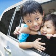 Cute sibling in car - Stock Photo