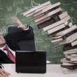 Stress businessman with falling books at class — ストック写真