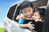Cute sibling in car — Stock Photo
