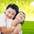 Cute brother and sister at park — Stock Photo