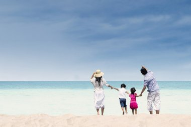 Happy family at white sand beach, Australia