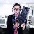 Crazy businessman hold keyboard at office — Stock Photo
