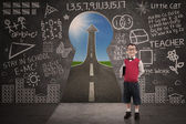 Boy student smiling in class with success road behind keyhole — Stock Photo