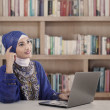 Asian female muslim thinking at library — Stock Photo #26097743