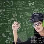 Asian graduate writing on board in class — Stock Photo #26098293