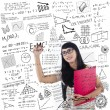 Asian female student write on whiteboard — Stock Photo