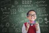 Asian boy student hold learn block in class — Stockfoto