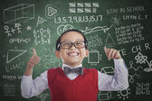 Asian student boy show thumbs up in class — Stock Photo