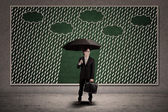 Businessman and umbrella with copyspace — Stock Photo