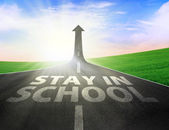 Road with up arrow sign and stay in school text — Stock Photo