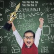 Happy student boy hold trophy in class — Stock Photo