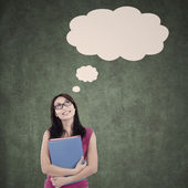 Beautiful student with blank cloud thinking in class — Stock Photo