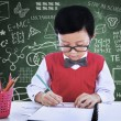 Asian boy drawing on paper in class — 图库照片 #26616339
