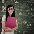 Asian female student at classroom - Stock Photo