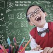 Boy student laughing in class — Stock Photo