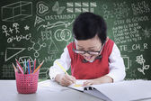 Cheerful boy drawing in class — Stock Photo