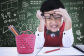 Funny expression of student boy in class — Stock Photo