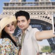 Couple take picture at Eiffel tower, Paris — Stock Photo #26730537