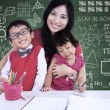 Happy family posing in class — Stock Photo