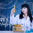 Beautiful doctor examine liquid in tubes — Stock Photo #26847385