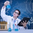 Beautiful scientist analysing solution on blue background — Stock Photo
