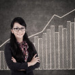 Businesswoman and growing bar chart — Stock Photo