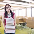 Stock Photo: Happy female student bring stack of books and clock