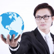Businessman giving world globe on white — Stock Photo #27005229