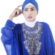 Stock Photo: Confused female muslim in blue dress - isolated