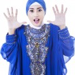 Stock Photo: Excited female muslim in blue dress - isolated