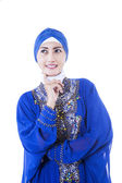 Beautiful female muslim in blue dress - isolated — Stock Photo