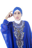 Confused female muslim in blue dress - isolated — Stock Photo