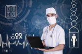 Doctor holding laptop on digital background — Stok fotoğraf