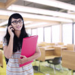 Asian female student calling in classroom — Stock Photo
