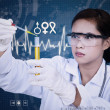 Beautiful female scientist using pipette on digital background — Stock Photo