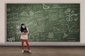 Beautiful female student and hand drawn chalkboard — Stock Photo