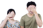 Asian couple cover face - isolated — Stock Photo